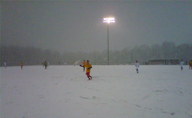Academy Play In Snowy Whiteout Conditions
